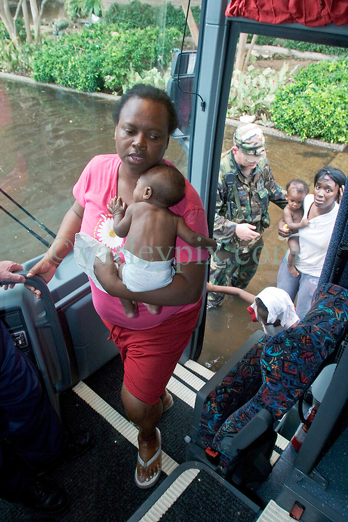 01 Sept, 2005. New Orleans, Louisiana.<br /> Louisiana. Mass evacuation begins. Women and children first. Exhausted mothers with children get on the first bus departing New Orleans.<br /> Photo©; Charlie Varley/varleypix.com