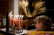young boy Lights the Channukah Menorah