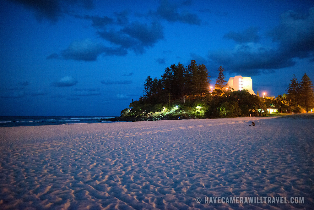 """Looking towards Pat Fagan Park on the headland at Coolangatta at dusk. Sometimes paired as """"Twin Towns,"""" Coolangatta and Tweed Heads, on the southern end of the Gold Coast, straddle the Queensland-New South Wales border."""