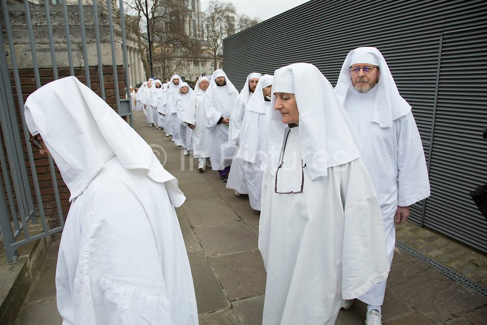 The Druid Order Spring Equinox ceremony held at Tower Hill Terrace in London, England, United Kingdom. The druids hold a ceremony celebrating the rise of the light. Ceridwen, the earth mother, brings token seeds which are symbolically sown around a circle. The concern of The Druid Order is with the evolution of humanity in harmony with the universe and to teach through open meetings, ceremonies, meditation and ritual.