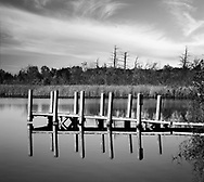 A small dock on Lake Sixteen during autumn, Oakland County Michigan. USA