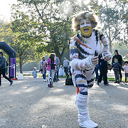 A hundreds of people participate dresses up in animal costume for the first Race for Nature a 10k run fundraising for the Natural History Museum in Hype park  London, UK,