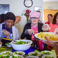 Dorothy Pouges, left, Eve Johnson and Linda Alane serve up plates for the Immanuel Baptist Church Thanksgiving dinner at the Community Outreach Center in Grants Saturday.