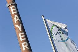 26.02.2015, Bayer-Kommunikationszentrum, Leverkusen, GER, Bilanzpressekonferenz Bayer AG, Ergebnisse des Geschäftsjahres 2014, im Bild Bayer Fahne im Wind mit Schornstein im Hintergrund // during a Annual Press Conference Bayer AG at the Bayer-Kommunikationszentrum in Leverkusen, Germany on 2015/02/26. EXPA Pictures © 2015, PhotoCredit: EXPA/ Eibner-Pressefoto/ Schueler<br /> <br /> *****ATTENTION - OUT of GER*****