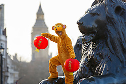 © Licensed to London News Pictures. 08/02/2016. London, UK. A Chinese dancer from the London Chinatown Chinese Association dressed as monkey posing at a photo call to welcome in the Year of the Monkey in Trafalgar Square, London on Monday, 8 February 2016. Photo credit: Tolga Akmen/LNP