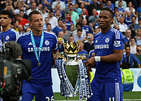 Football - 2014 / 2015 Premier League - Chelsea vs. Sunderland.   <br /> <br /> Chelsea's John Terry and Didier Drogba with the Premier League Trophy at Stamford Bridge. <br /> <br /> COLORSPORT/DANIEL BEARHAM
