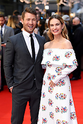 Lily James (right) and Glen Powell attending the world premiere of The Guernsey Literary and Potato Peel Pie Society at the Curzon Mayfair, London. Photo credit should read: Doug Peters/EMPICS Entertainment