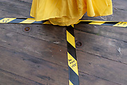 Hazard tape stretches across an outdoor table of a cafe business, now only open for takeaways, in Stratford during the second wave of the Coronavirus pandemic, on 26th November 2020, in London, England. Stratford was the home iof the London 2012 Olympics where industrial estates centred around Carpenters Road were demolished to make way for sports venues  and now, after 8 years, for extensive housing.