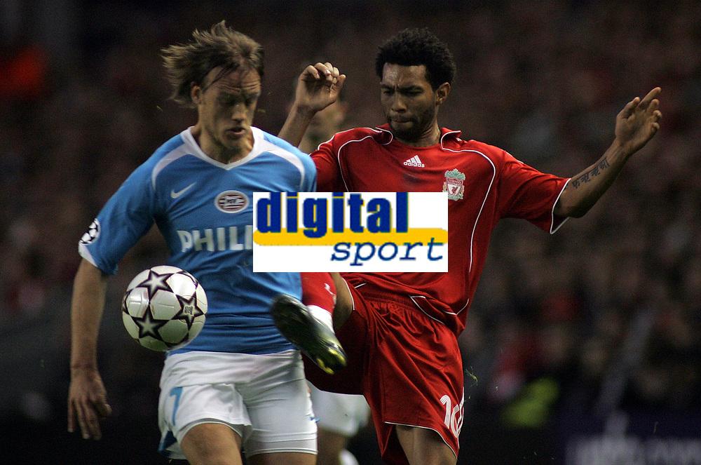 Photo: Paul Thomas.<br /> Liverpool v PSV Eindhoven. UEFA Champions League. Quarter Final, 2nd Leg. 11/04/2007.<br /> <br /> Jermaine Pennant (R) of Liverpool battles Mika Vayrynen.