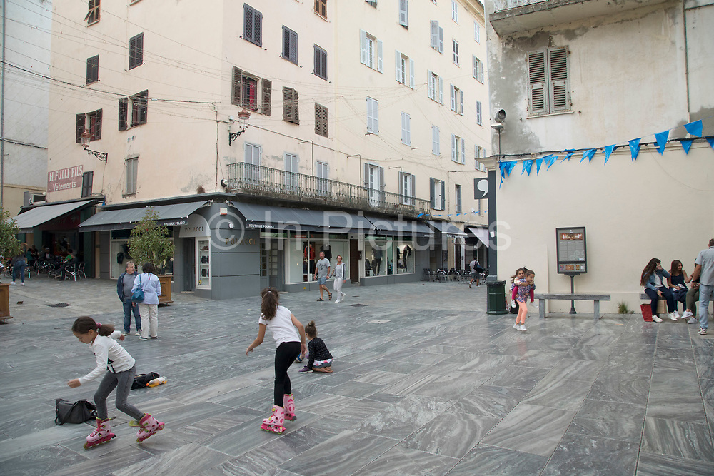 Kids playing in the street on 16th September 2017 in Bastia, Corsica, France. Bastia is a French commune in the Haute-Corse department of France located in the north-east of the island of Corsica at the base of Cap Corse. Bastia is the principal port and commercial town of the island. The inhabitants of Bastia are known as Bastiais or Bastiaises.