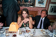 ELIZABETH HURLEY; VALENTINO, Graydon Carter hosts a diner for Tom Ford to celebrate the London premiere of ' A Single Man' Harry's Bar. South Audley St. London. 1 February 2010
