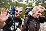 Brian Bernhardt and Kate Clark celebrate being out on the trail backpacking up Baker Gulch, Never Summer Wilderness, Colorado.