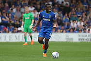 AFC Wimbledon defender Deji Oshilaja (4) dribbling and with his hands open making a gesture during the EFL Sky Bet League 1 match between AFC Wimbledon and Oldham Athletic at the Cherry Red Records Stadium, Kingston, England on 21 April 2018. Picture by Matthew Redman.