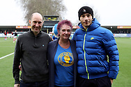 AFC Wimbledon defender Rod McDonald (26) with fans during the EFL Sky Bet League 1 match between AFC Wimbledon and Barnsley at the Cherry Red Records Stadium, Kingston, England on 19 January 2019.