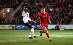 Wales' George Thomas celebrates briefly before seeing his goal disallowed for being off-side during the International Friendly match at the Racecourse Ground, Wrexham.