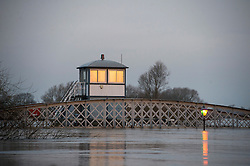 © Licensed to London News Pictures. 28/12/2015. Cawood, UK. The bridge and a street light poke above fold water on the river Ouse at  Cawood in North Yorkshire where flood water and rising tides have threatened the town on December 28, 2015. Several warnings of risk to life are sill in place in parts of Lancashire and Yorkshire where rainfall has been unusually high, causing heavy flooding. Photo credit: Ben Cawthra/LNP