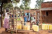 View of people at water pump in Musoto village, Mbale, Uganda, Africa
