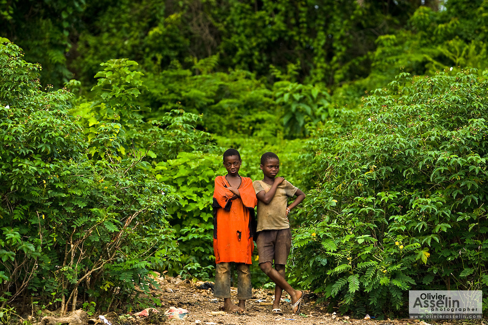 Two boys stand by the edge of the forest in Tano Akakro, Cote d'Ivoire on Saturday June 20, 2009.