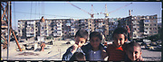 Children in a Macroyan apartment complex in Kabul. The Soviet halted its construction and left Afghanistan in 1989. The complex was still incomplete in 2007 and became home of many displaced families along with middle to upper-class Afghans.