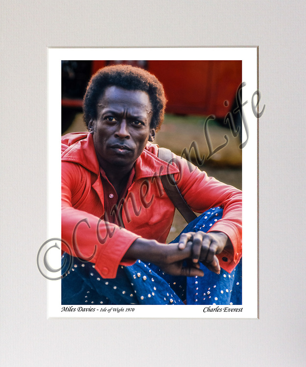 Miles Davis (sitting)