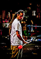 A capture of a glass worker that conveys the glow of the glory holes where the glass is kept in a molten state.