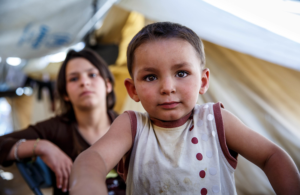 2016 July-Ritsona Refugee Camp, Ritsona, Greece. Muhamed,3, with his sister, Fatimah, 13, from Aleppo, Syria.