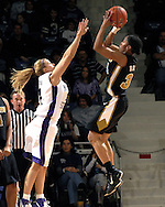Missouri guard Tiffany Brooks (R) scores over pressure from Kansas State guard Claire Coggins (L) during the second half at Bramlage Coliseum in Manhattan, Kansas, January 13, 2007.  K-State beat the Tigers 81-66.