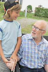 Grandfather with grandson at nursing home, Bavaria, Germany