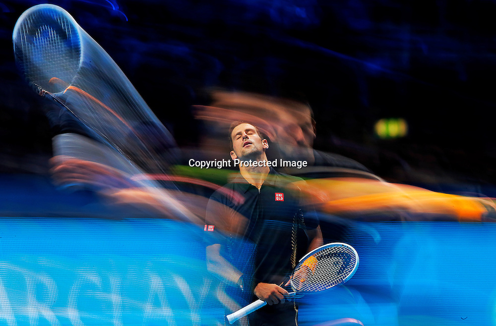 A multiple exposure picture shows Novak Djokovic of  Serbia  during his match against Tomas Berdych of Czech Republic at the ATP World Tour Finals in London, Britain, 09 November 2012.  EPA/KERIM OKTEN