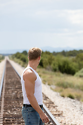 man looking at railroad tracks in New Mexico