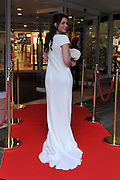 © Licensed to London News Pictures. 26/10/2011. London, UK. A Pippa Middleton lookalike wears a bridesmaid dress inspired by Ms Middleton's real dress worn to the wedding of Prince William and Katherine Middleton. It is to go on limited edition sale at high street store Debenhams costing £170, the original cost £20,000. Today 26 October 2011. Photo: Stephen Simpson/LNP