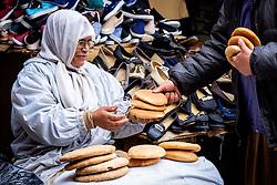 A woman selling bread in the medina in Marrakech, Morocco, North Africa<br /> <br /> (c) Andrew Wilson | Edinburgh Elite media