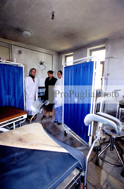 FAIZABAD PROVINCIAL HOSPITAL, 27 July 2005....UNFPA Staff and local Doctors inspect the operating theatre at the main Hospital.....According to United Nations Population Fund, Afghanistan has among the world?s highest rates of maternal mortality, and Badakhshan has the highest rates ever recorded anywhere in the world, with one mother dying in every 15 births. ..Lack of medical infrastructures is one of the primary causes of maternal mortality...