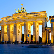 Panorama of evening view of the Brandenburg Gate, one of Europe's and the world's most recognizable and historic landmarks in Berlin, the capital of Germany. This shot is from slightly to one side.