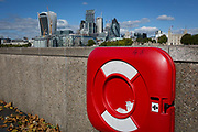 In the foreground, a red life ring and in the distance, the capitals financial district aka The Square Mile, on 5th October, 2017, in London, England.