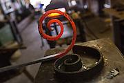 Freshly shaped red hot steel in an metal shop in Charleston, SC