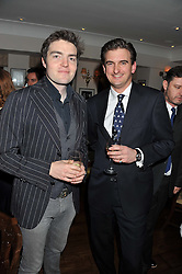 Left to right, actor TOM BURKE and OLIVER SHUTTLEWORTH at Shepherd's Delight an evening of Dinner & Entertainment in aid of The National Youth Theatre of Great Britain held at Shepherd's, Marsham Street, London on3rd December 2012.