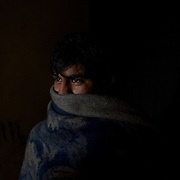 Abbas Khan, a 21 year old Pakistani migrant living for the past four months in a makeshift shelter near Belgrade's main railway and bus stations, in Serbia. As the majority of the migrants living here, Mr. Khan awaits the opportunity to cross the border with Hungary or Croatia so he can proceed his journey towards western Europe.