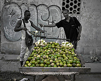 Vendor Peeling Sour Oranges in Old Havana. Image taken with a Leica T camera and 23 mm f/2 lens (ISO 100, 23 mm, f/2, 1/500 sec). Raw image processed with Capture One Pro and Photoshop CC.