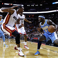 19 March 2011: Miami Heat power forward Chris Bosh (1) defends on Denver Nuggets point guard Ty Lawson (3) during the Miami Heat 103-98 victory over the Denver Nuggets at the AmericanAirlines Arena, Miami, Florida, USA.