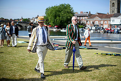 © Licensed to London News Pictures. 04/07/2018. Henley-on-Thames, UK. Two men wearing rowing club colours on day one of the Henley Royal Regatta, set on the River Thames by the town of Henley-on-Thames in England. Established in 1839, the five day international rowing event, raced over a course of 2,112 meters (1 mile 550 yards), is considered an important part of the English social season. Photo credit: Ben Cawthra/LNP