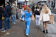 Young woman wearing light blue Juicy Couture outfit on 15th April 2021 in London, United Kingdom. Juicy Couture is a casualwear and dress clothing brand based in California.