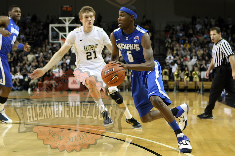 Memphis guard Will Barton (5) drives past Central Florida forward P.J. Gaynor (21) during a Conference USA NCAA basketball game between the Memphis Tigers and the Central Florida Knights at the UCF Arena on February 9, 2011 in Orlando, Florida. Memphis won the game 63-62. (AP Photo: Alex Menendez)