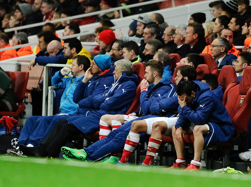 Arsenal manager Arsène Wenger and the bench including Santi Cazorla with head in hands watch on as Monaco win 3-1 at the Emirates Stadium<br /> <br /> Photographer Ashley Western/CameraSport<br /> <br /> Football - UEFA Champions League Second Round 1st Leg - Arsenal v Monaco - Wednesday 25th February 2015 - Emirates Stadium - London<br /> <br /> © CameraSport - 43 Linden Ave. Countesthorpe. Leicester. England. LE8 5PG - Tel: +44 (0) 116 277 4147 - admin@camerasport.com - www.camerasport.com