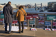 Three days after the killing of Jack Merritt, 25, and Saskia Jones, 23, by the convicted teorrorist Usman Khan at Fishmongers' Hall on London Bridge, a memorial organised by Faiths Forum appeared on the bridge showing the faces of victims and their friends, in the City of London, on 2nd December 2019, in London, England.