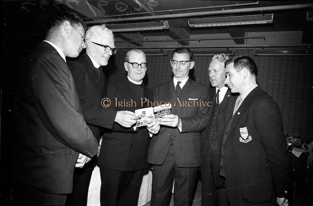 """17/05/1966<br /> 05/17/1966<br /> 17 May 1966<br /> Book reception for """"Decades of Glory: A Comprehensive History of the National Game"""" by Raymond Smith.<br /> This reception was held in the offices of W.D. & H.O. Wills to honour the well known author and journalist, Raymond Smith. His book on the history of Hurling (""""Decades of Glory"""") has just been published with the assistance of Wills of Dublin and Cork and the Central Council of the G.A.A.<br /> Picture shows tipperary players and officials of the G.A.A., who attended the reception. From left to right: Jimmy Smith (Executive Officer of the G.A.A.), Rev. Fr. Hilery Barry (C.P. Mount Argus, Dublin), Rev. Brother J. Hutton (Superior, C.B.S. Thurles), Raymond Smith (author), Jim Ryan (Chairman of the Munster Board), and Jimmy Doyle (Tipperary hurler)."""