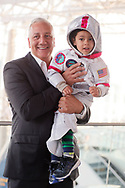 Garden City, New York, USA. June 21, 2018. NASA space shuttle astronaut MIKE MASSIMINO poses holding GIOVANNI, a 3 1/2 year old boy wearing a spacesuit costume, from Manhasset, before the former astronaut gave a lecture at the Cradle of Aviation Museum.