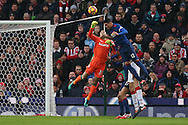 Lee Grant, the Stoke city goalkeeper punches clear from Chris Smalling of Manchester Utd. Premier league match, Stoke City v Manchester Utd at the Bet365 Stadium in Stoke on Trent, Staffs on Saturday 21st January 2017.<br /> pic by Andrew Orchard, Andrew Orchard sports photography.