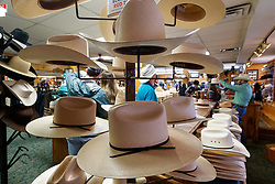 Hats on display at M.L Leddy's Boots, Fort Worth Stockyards National Historic District, Fort Worth, Texas, USA.