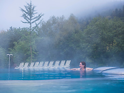 Woman relaxing in swimming pool of Paracelsus-Therme, Bad Liebenzell, Baden-Württemberg, Germany